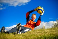 Save by goalie. Teen laying on grass area with soccer ball Royalty Free Stock Photo