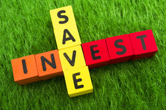 Save and Invest. Alphabet blocks spelling save and invest stock image