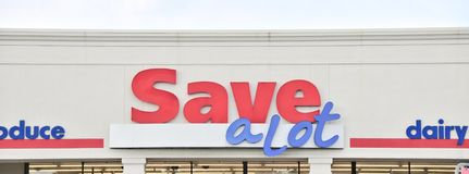 Save a Lot Grocery Store Sign Close-Up. Save a lot grocery store where shoppers can pick up food and other household items at extra savings Royalty Free Stock Images