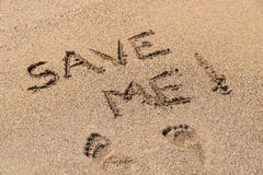 Save Me Sign Drawn On Sand. Save Me Sign Drawn On Beach Sand Stock Image
