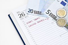 Save money. Reminder in the calendar that it is time to save money Royalty Free Stock Image