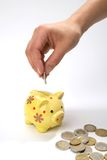 Save money. Hand with coin,money-box Royalty Free Stock Photography