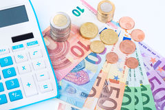 Save money. Blue calculator with euro money Royalty Free Stock Image
