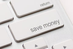 Save Money button key. Save money for investment concept with a blue button on computer keyboard Stock Photography