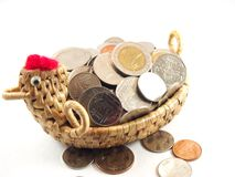 Save money with coins collection on weave basket Royalty Free Stock Image