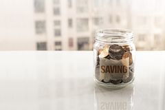 Save money, coins in glass jar for money saving financial concept royalty free stock images