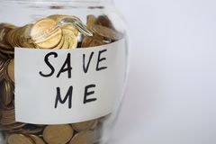 Save money, Coins in a piggy on a light background, investment concept, Inscription Save me royalty free stock photography