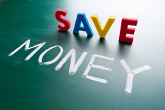 Save money concept. Message words on blackboard Royalty Free Stock Photos