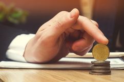 Save money and investment concept. Ukrainian coins. Businessman hand/ finance royalty free stock photo