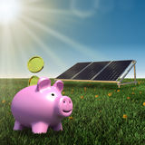 Save money- solar panel with piggy bank Stock Photo