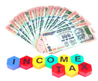Save money for tax. Currency notes for income tax Stock Photos