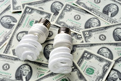 Save money by using energy savings light bulbs Royalty Free Stock Photos