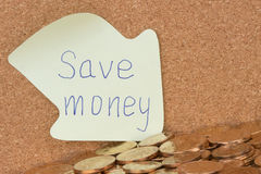Save money written on sticky note Royalty Free Stock Photo