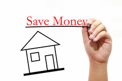 Save Moneyl - House with text and male hand with pen - Real Esta. House with text and male hand with pen Stock Photography