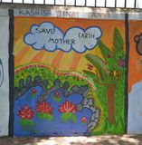 Save Mother Earth. ! Children`s drawing on the wall in Mumbai, India stock photography