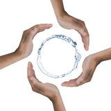 Save the nature. 4 hands protecting a ring of water. Picture was made in a studio Stock Photos