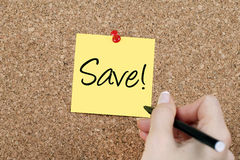 Save Note. Woman hand writing Save note Royalty Free Stock Photography