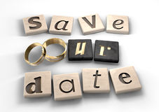Save Our Date. Square wood tiles engraved with various letters spelling out the term save our date with two gold wedding bands as the o Royalty Free Stock Photos