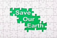 Save our earth word reveal under jigsaw puzzle royalty free stock photography