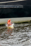 Save Our Souls. During SOLAS training seaman jump to the water from vessel Stock Photo