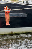 Save Our Souls. During SOLAS training seaman jump to the water from vessel Royalty Free Stock Image