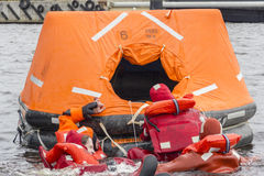 Save Our Souls. During SOLAS training seamen try to save their lives by onboarding to the rescue craft Stock Photos