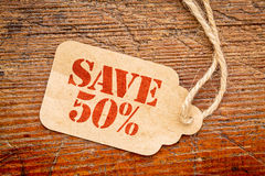 Save 50 percent sign  on a price tag Royalty Free Stock Photos