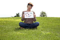 Save the Planet. Aging hippie holding a sign with a message for the younger generation:  Save the Planet Stock Images