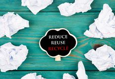 Save the planet concept - crumpled paper around a blackboard in shape of heart and text Reduce reuse recycle royalty free stock image