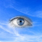 Save planet earth. Conceptual image depicting - Save planet earth - with an eye in blue sky depicting awareness, responsibility, watching over and protecting Royalty Free Stock Photos
