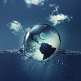 Save the planet. Earth globe on the water waves, abstract natural backgrounds Royalty Free Stock Image