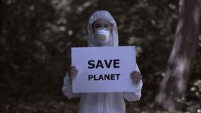 Save planet sign female hands, radiation danger research, toxic planet, future