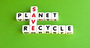 Save the planet. Text ' save the planet recycle ' in uppercase letters  crossword style green background Stock Photo
