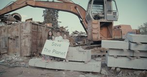 Young kids holding save the planet signs standing in a huge junkyard. Save The planet. young kids holding signs for saving planet earth stock video