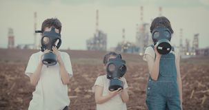 Save the planet. Kids wearing gas masks near an oil refinery