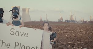 Save the planet. kids standing near a refinery wearing gas masks. Save the planet. young kids standing with gas masks stock video footage