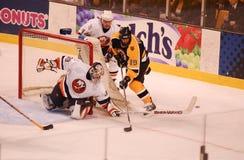 Save Rick DiPietro. Islanders goalie Rick DiPietro has a stick save against Bruins Joe Thornton.   Image taken from a color slide Stock Photos