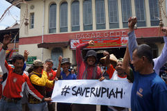 Save rupiah. Traditional market traders calling the save rupiah because its exchange rate against the US dollar slumped in the city of Solo, Central Java Royalty Free Stock Photography