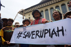 Save rupiah. Traditional market traders calling the save rupiah because its exchange rate against the US dollar slumped in the city of Solo, Central Java Stock Photography