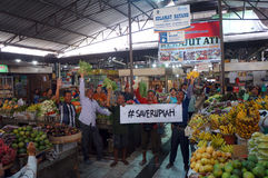 Save rupiah. Traditional market traders calling the save rupiah because its exchange rate against the US dollar slumped in the city of Solo, Central Java Royalty Free Stock Image