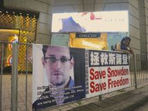 Save Snowden, Save Freedom - Pro Snowden Sign in Hong Kong. HONG KONG - JUNE 19, 2013: A sign posted by supporters of Edward Snowden, the NSA leaker hiding in Stock Photo