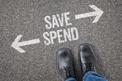 Save or Spend. Decision at a crossroad - Save or Spend Stock Photography
