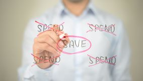 Save, Spend Illustration, Man writing on transparent screen royalty free stock photography