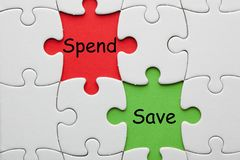 Save Spend Concept. Save Spend Invest text on colorful pieces paper puzzle. Business concept stock image