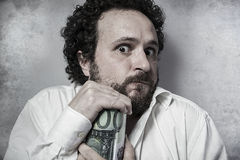 Save, stingy businessman, saving money, man in white shirt with Royalty Free Stock Photography