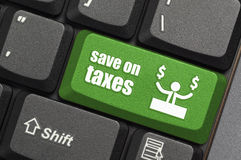 Save on taxes key on keyboard stock photos