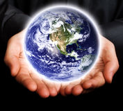 Save The Earth Concept - Hands And Glowing World Royalty Free Stock Images