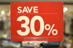 Save thirty percent red sign board. Against a store background Stock Photo