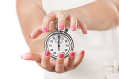 Save Time Concept. Two Woman Hands Protecting Stopwatch. Stock Images