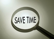 Save time. Magnifying glass with the word save time. Searching save time Stock Photo